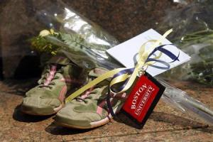 A pair of running shoes is seen at a makeshift memorial on Boston University's campus in memory of the Boston University Graduate student who was killed in the explosions at the Boston Marathon in Boston