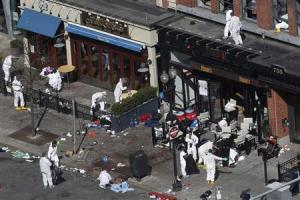 Officials take crime scene photos two days after two explosions hit the Boston Marathon in Boston