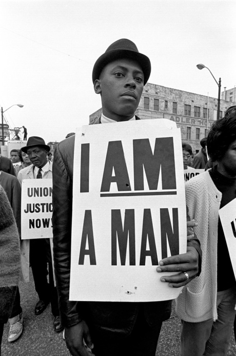 "1968, Memphis, Tennesee, USA --- At the memorial just after Martin Luther King's asassination, mourners gather downtown , Some display picket signs ""I am a man"". used by striking garbage men. Memphis, TN. --- Image by © Bob Adelman/Corbis"